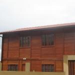 Calha marrom - casa de madeira